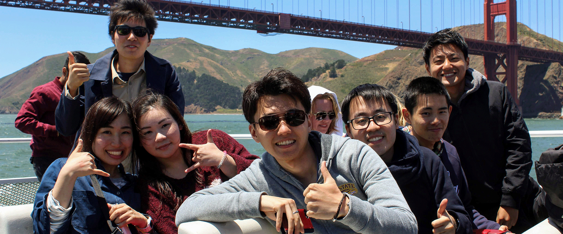 American Language Institute students take a bay cruise by the Golden Gate Bridge