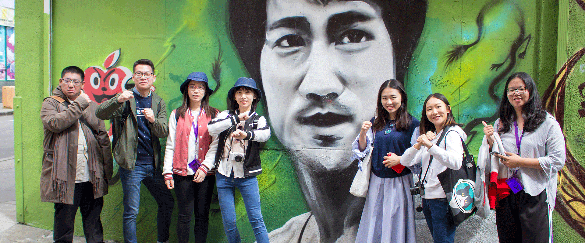 San Francisco Discover international students stand in front of Bruce Lee mural