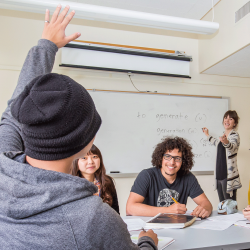 Student raises his hand in class, and teacher calls on him
