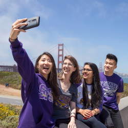 SF State students take a selfie at the Golden Gate Bridge