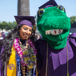 SF State graduate with the Gator mascot