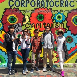 San Francisco Discover international students in front of Capitalism mural